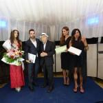 Il momento della premiazione a Carlo Riccardi per mano  di Mirca Viola